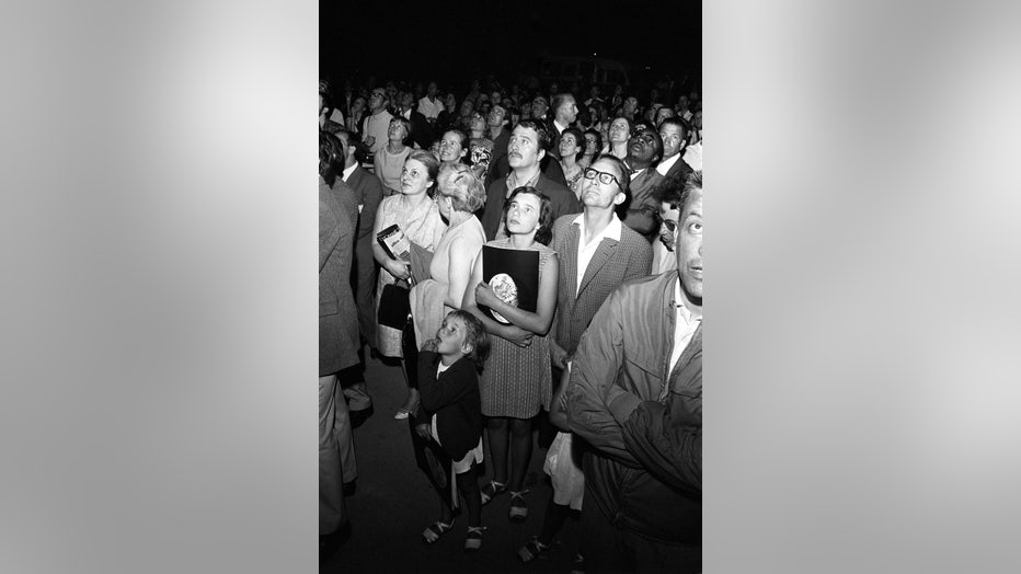 FRANCE: Crowd watching the images of Apollo 11 in Paris, France on July 21, 1969.