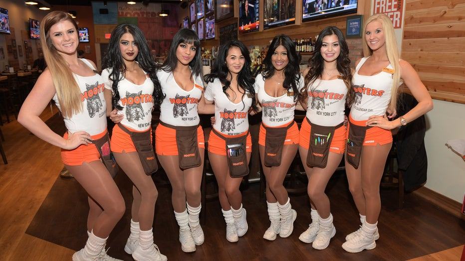 Hooters girls are pictured in a file photo taken at Hooters Manhattan on January 15, 2015 in New York City. (Photo by Grant Lamos IV/Getty Images)