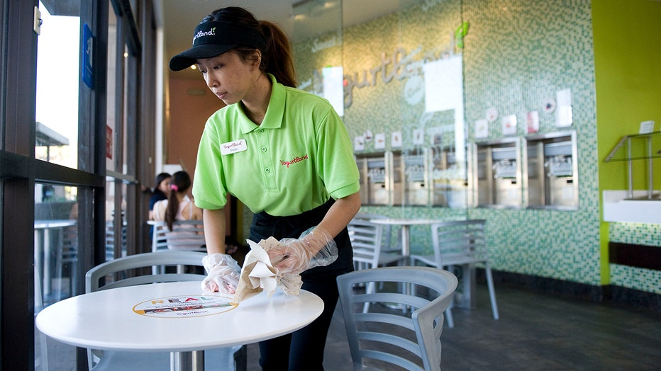 Vivian Pham, a community college student, works hersummer job as an associate at Yogurtland. Vivian didn't get her first job until after graduating high school. Her mom, who waitressed during high school as a single mom, encouraged her to focus on her studies instead of working during high school.