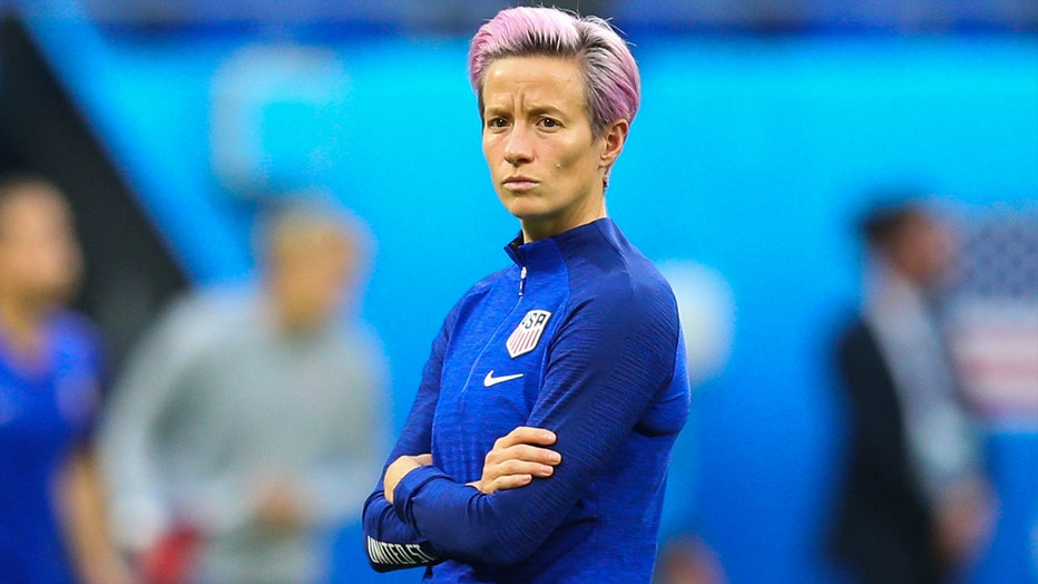 Megan Rapinoe of USA looks on during the pre-match warm-up. Rapinoe has expressed disappointment the final match will take place on the same day as two major men's soccer event finals.