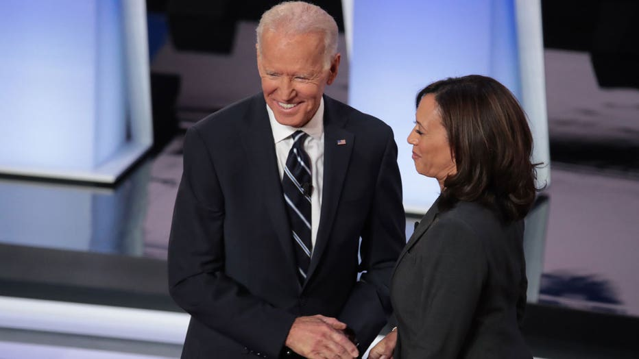 Former Vice President Joe Biden smiles as he shakes hands with Sen. Kamala Harris during the opening of night two of the second set of Democratic debates in Detroit, Michigan, on July 31, 2019.
