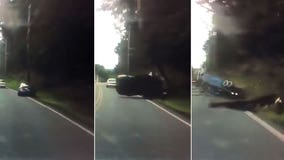 Don't text and drive: Police share video of distracted driver crashing car into utility pole