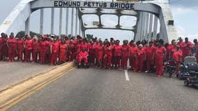 100 'Ladies in Red' cross historic bridge in Selma, Alabama on civil rights tour