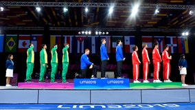 American gold medalist kneels during national anthem at Pan Am Games