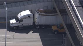 Tractor-trailer lodged underneath pedestrian bridge at PHL removed