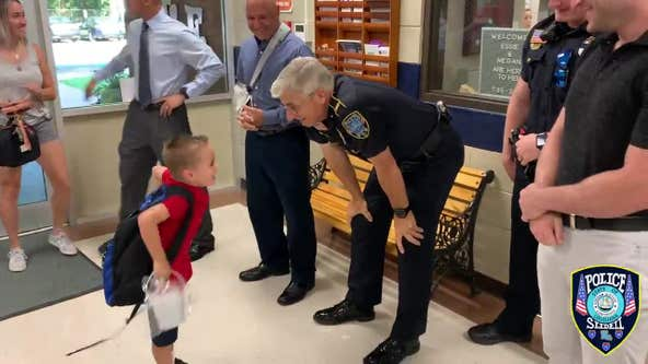 Son of fallen officer receives warm welcome from police on first day of kindergarten