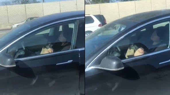 'He's totally asleep': Video shows Tesla driver asleep behind wheel on 5 Freeway in Santa Clarita