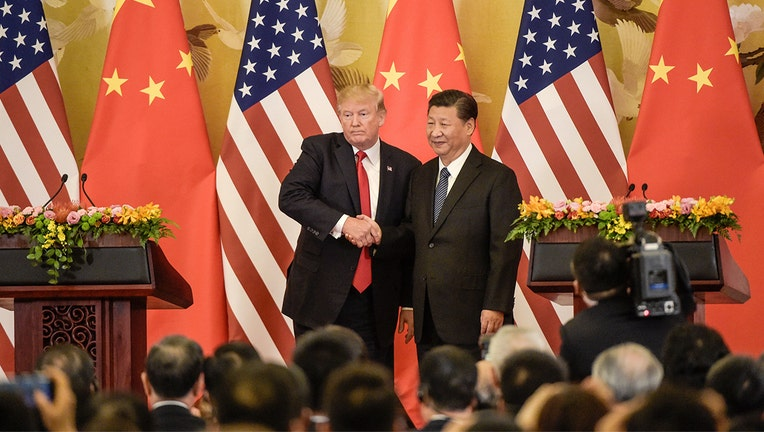 US President Donald Trump (L) shakes hands with China's President Xi Jinping at the end of a press conference at the Great Hall of the People in Beijing on November 9, 2017. Donald Trump and Xi Jinping put their professed friendship to the test on November 9 as the least popular US president in decades and the newly empowered Chinese leader met for tough talks on trade and North Korea. / AFP PHOTO / Fred DUFOUR (Photo credit should read FRED DUFOUR/AFP/Getty Images)