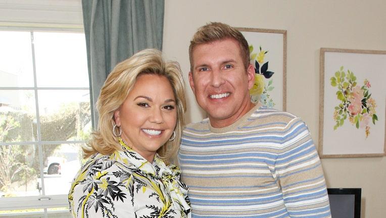 UNIVERSAL CITY, CA - JUNE 18: Reality TV Personalities Julie Chrisley (L) and Todd Chrisley (R) visit Hallmark's