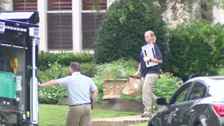 Officials in Allen, Texas search the El Paso shooter's grandparent's home for evidence.