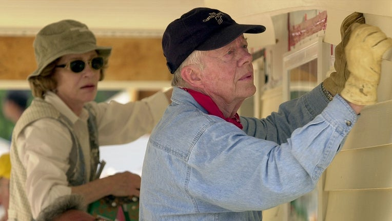 Former President Jimmy Carter and his wife Rosalynn at Habitat for Humanity event.
