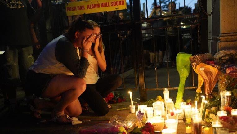 Vigil honors shooting victims as authorities eye Ohio gunman's life