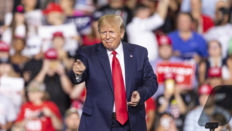 U.S. President Donald Trump speaks during campaign MAGA rally at Southern New Hampshire University Arena.