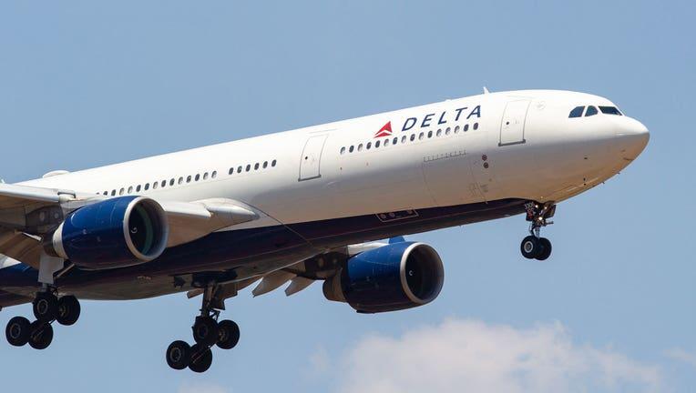 49ab3bdc-A Delta Airlines flight is shown in a file photo. (Photo by Nicolas Economou/NurPhoto via Getty Images)