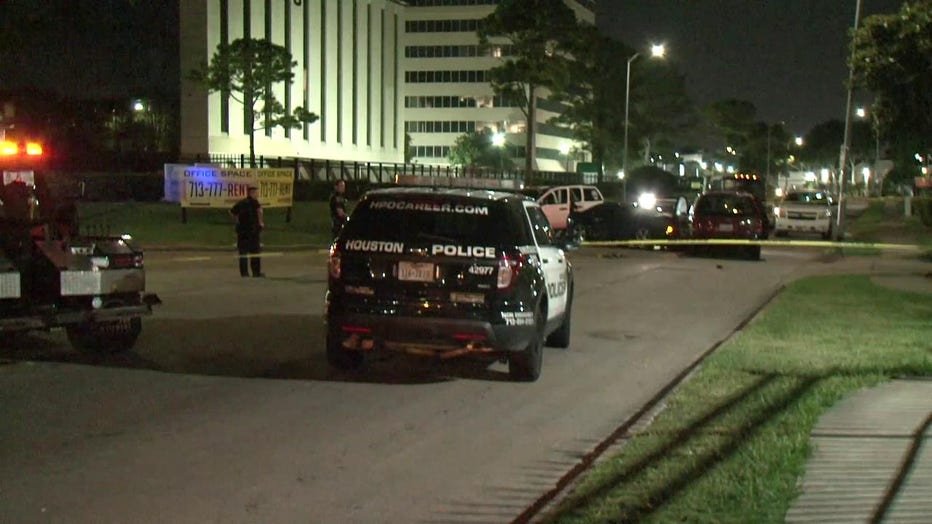 Houston police say a man's legs may have to be amputated after he tried to stop a suspect from stealing a car with his wife inside.