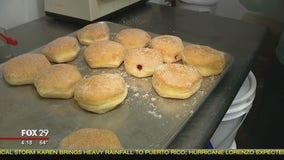 Bob Kelly fills jelly donuts at Angelina's Bake Shop