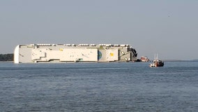 Coast Guard: 4 crew members missing from overturned cargo ship