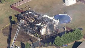 Crews battle massive house fire in Gloucester County