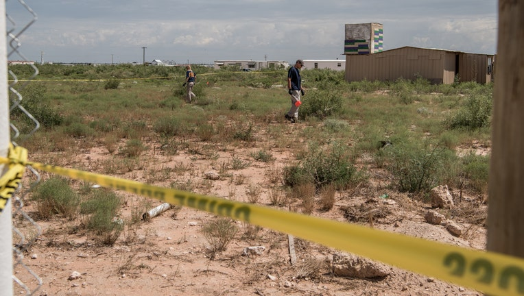 WEST ODESSA, TX - SEPTEMBER 1: FBI agents search a home believed to be linked to a suspect following a deadly shooting spree on September 1, 2019 in West Odessa, Texas. Seven people had been killed, in addition to the gunman and at least 21 others were wounded, including three law enforcement officers after a gunman went on a rampage. The man who has not been identified fled from state troopers who had tried to pull him over. The gunman then hijacked a United States postal van and indiscriminately fired from a rifle at people before the authorities shot and killed him outside a movie theater in Odessa. (Photo by Cengiz Yar/Getty Images)
