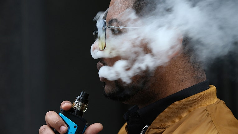 Man using a vaping device