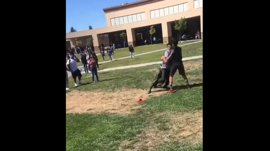 A U.S. Marine tackles two high school students in Stockton, Calif.