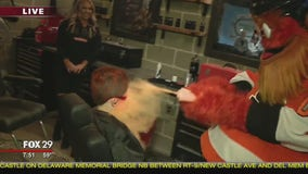 Jenn hangs with Gritty in the new C.O.M.M.A.N.D. Center ahead of home opener