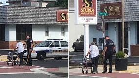 Ocean City's Finest: Police officer photographed helping elderly woman cross busy intersection