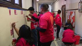 Dozens of volunteers brighten and 'sparkle' West Philadelphia elementary school