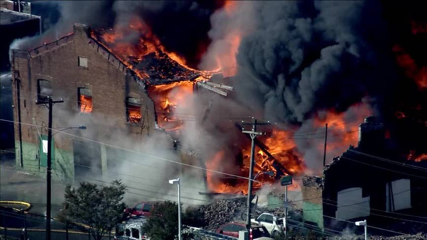 Crews respond to 3-alarm fire at West Philly auto body shop, nearby school evacuated
