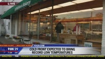 Cold front brings record low temps to region
