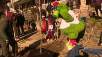 Phillie Phanatic plants trees in West Philadelphia