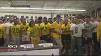 Local teen with Cystic fibrosis signs letter of intent with Rowan football team