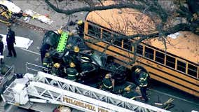 19-year-old critical after chain reaction crash leaves car wedged under school bus in West Philadelphia