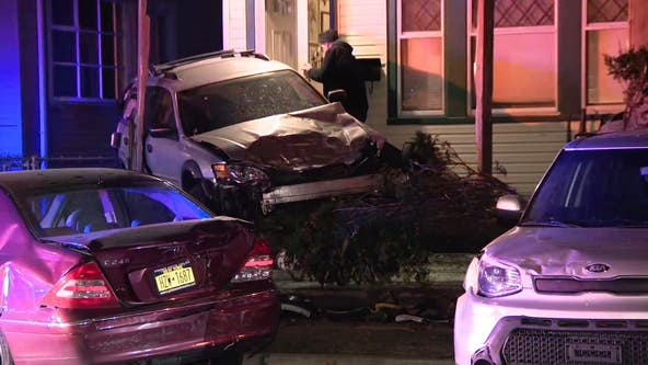 Multi-vehicle crash sends SUV into NJ home's porch