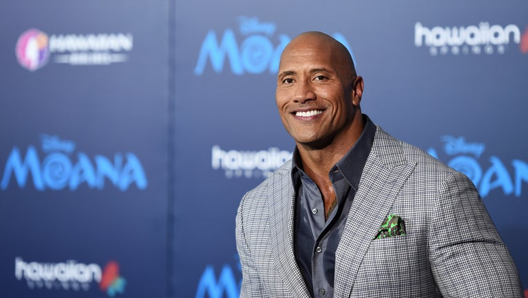 FILE - Dwayne Johnson and his family have tested positive for COVID-19. Johnson is seen at the AFI FEST 2016 Presented By Audi premiere of Disney's