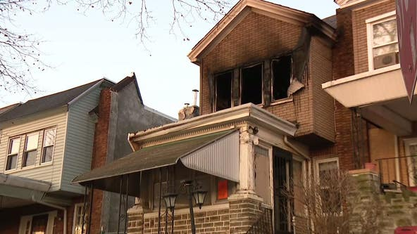 Crews battle early morning row home fire in Logan