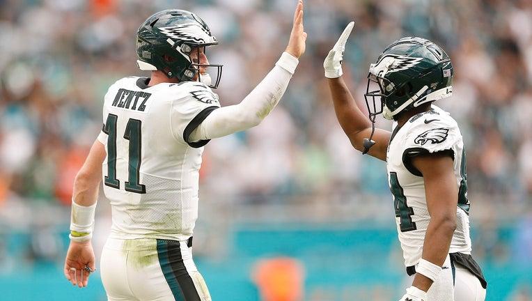 Carson Wentz high fives Greg Ward after a touchdown.