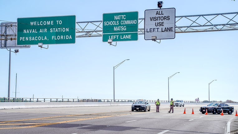 Florida State Troopers block traffic over the Bayou Grande Bridge leading to the Pensacola Naval Air Station following a shooting on December 06, 2019 in Pensacola, Florida. (Photo by Josh Brasted/Getty Images)