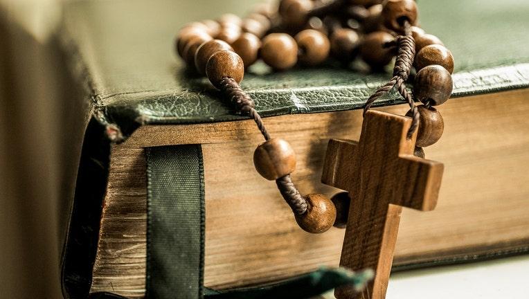 Bible with prayer beads