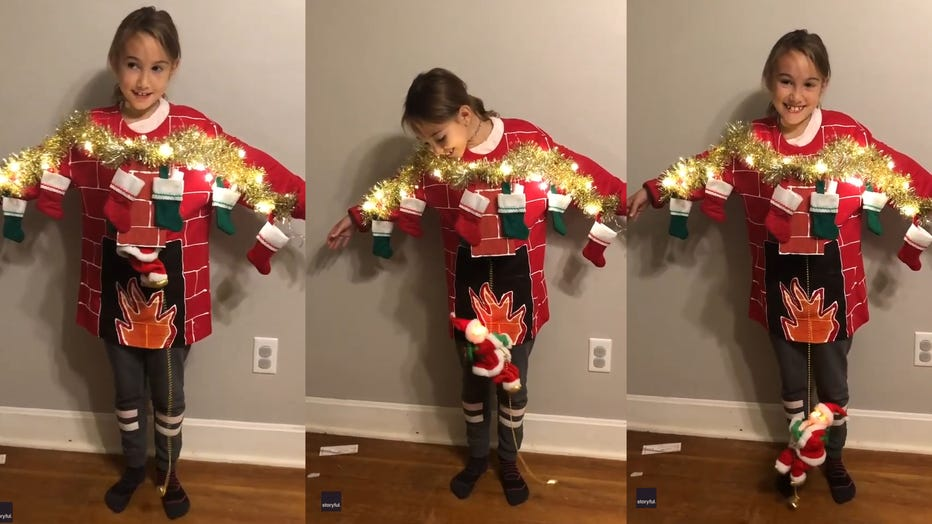 Layla, 8, is pictured wearing her mom's epic sweater creation in a video posted to Facebook. (Photo credit: Megan Grimes via Storyful)