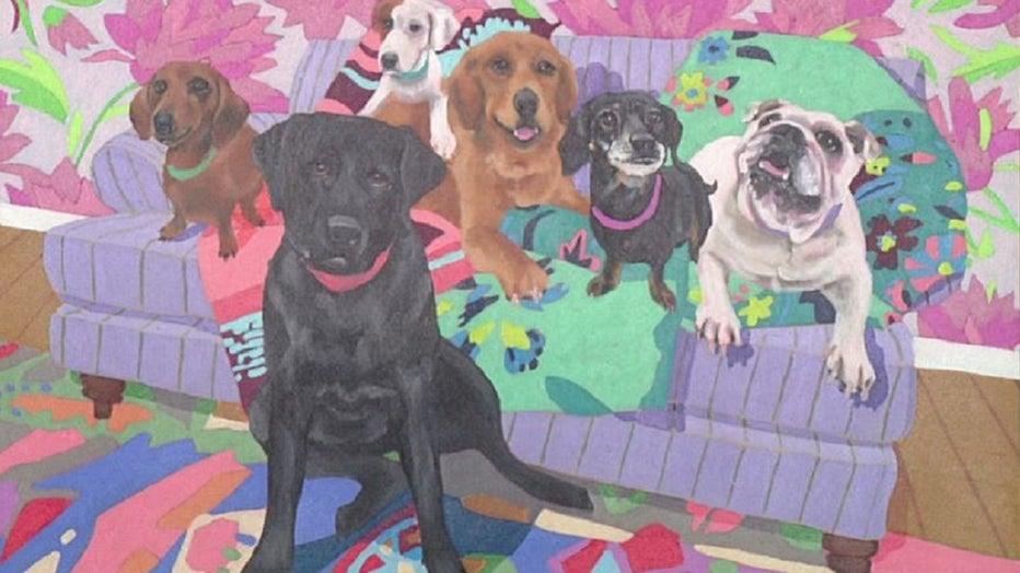 Artist Jay McClellan painting custom pet portraits for White Dog Cafe