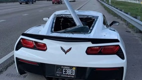 Roadway sign goes airborne, slices through rear window of Corvette on Florida highway