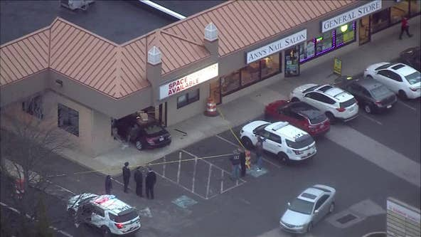 Car crashes into storefront at Northeast Philadelphia strip mall