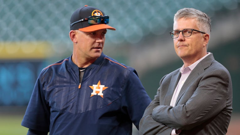 HOUSTON, TX - APRIL 04: Manager A.J. Hinch #14 of the Houston Astros and general manager Jeff Luhnow talk during batting practice at Minute Maid Park on April 4, 2017 in Houston, Texas.