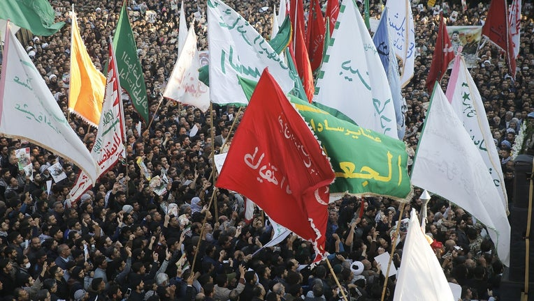 Iranians march in the streets of Ahvaz to pay homage to top general Qasem Soleimani.
