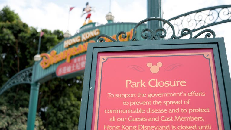 A sign announcing the park's closure is pictured at the entrance to Hong Kong Disneyland in Hong Kong on January 26, 2020, after it announced it was shutting its doors until further notice over a deadly virus outbreak in central China. (Photo by Ayaka MCGILL / AFP) (Photo by AYAKA MCGILL/AFP via Getty Images)