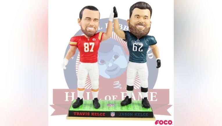 Kansas City Chiefs tight end Travis Kelce and Philadelphia Eagles center Jason Kelce appear in bobblehead form.