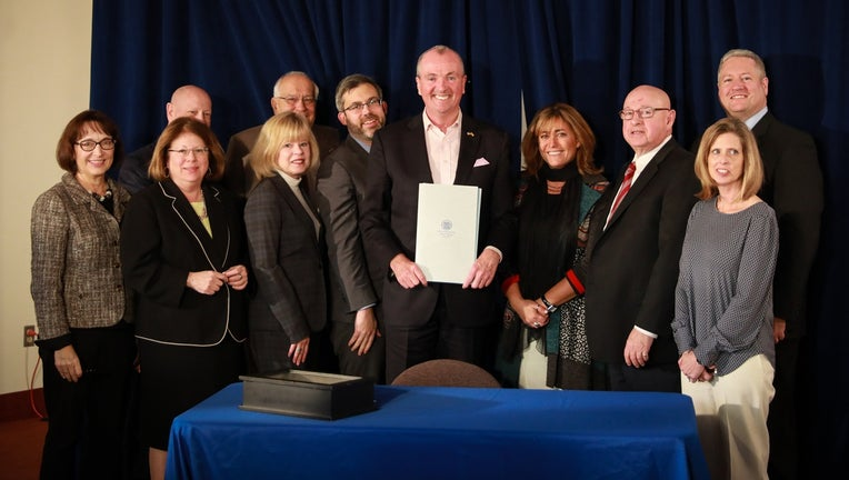 Gov. Phil Murphy signs legislation establishing goals and incentives for using electric vehicles in New Jersey.