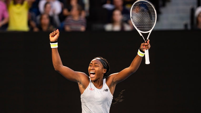 Coco Gauff celebrates after winning her third round match against Naomi Osaka on day five of the 2020 Australian Open at Melbourne Park on January 24, 2020 in Melbourne, Australia. (Photo by TPN/Getty Images)