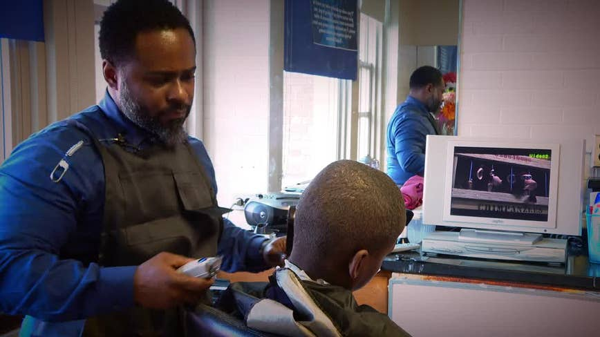 Wilmington principal bonds with young students through haircuts